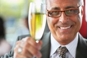 Businessman Raising Champagne Glass