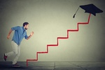 Concept of education target progress. Young man student running up career education ladder