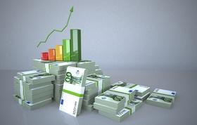 Balkendiagramm auf Geldstapel zeigt Wachstum