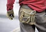 Bauarbeiter, Detail Werzeughalter an Hose