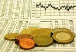 Börsenkurs_Zeitung_Dividende_Euromünzen