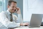 Business-Mann am Laptop
