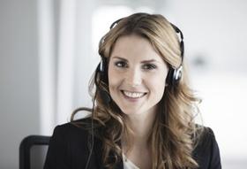 Businessfrau mit Headset