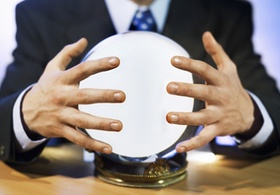 Close-up mid section of man touching crystal ball