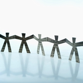 Close-up of paper chain figures