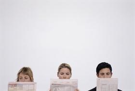 Drei Zeitungsleser