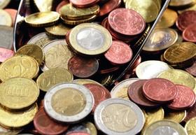 Geld Münzen mit Schaufel