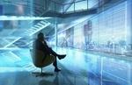 Geschäftsmann sitzt vor digitaler Leinwand