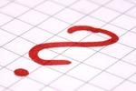 großes rotes Fragezeichen auf kariertem Papier