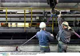 Workers Doing Maintenance Works In A Tube Rolling Mill