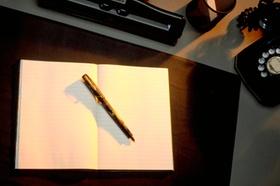 Heft mit Stift