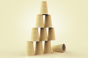 Illustration of plastic cups stacked in a pyramid with one fallen down, studio shot on beige backgro