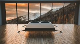 Hotel Hotelzimmer modern Panoramafenster Berge Bett