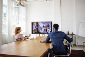 Businesspeople having a video conference in office. Business men  and women having a web conference