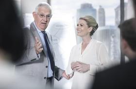 Senior businessman talking in meeting