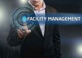 Businessman presses button facility management on virtual screens