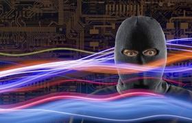 Mann mit Sturmmaske vor Elektroden