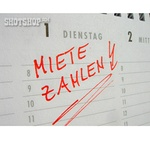 Miete zahlen Schriftzug rot auf Kalender