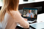 View over shoulder employer listen applicant at job interview online use cam and pc. To prevent spre
