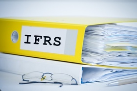 ifrs standards folder with accounting documents and financial reports