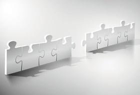 Puzzleteile greifen ineinander