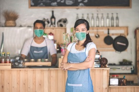 Portrait of waitress using digital tablet and wear face masks
