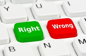 Right and Wrong buttons on a computer keyboard.