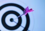 Close-up of arrow in bulls eye of target