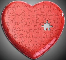 Rotes Herz aus Puzzle-Teilen