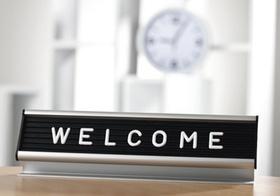 Schild Welcome in Buero