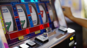 Person Playing Slot Machine