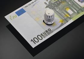 Symbolbild Heizkosten, Euroschein mit Thermostat
