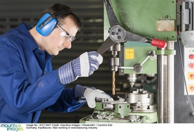 Germany, Kaufbeuren, Man working in manufacturing industry